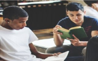 Adolescent boys reading books