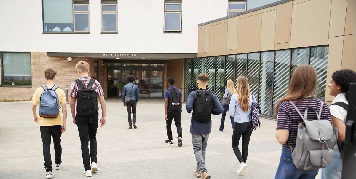 Secondary School Students walking into school